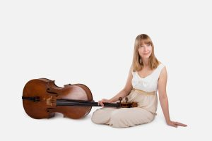Isabel Gehweiler and cello siting in white room